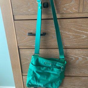 Green crossbody Tumi bag